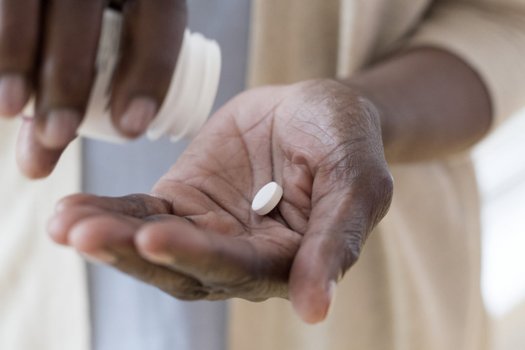 person taking painkiller