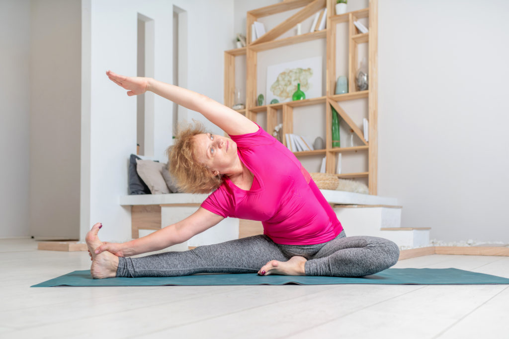 mature person doing yoga