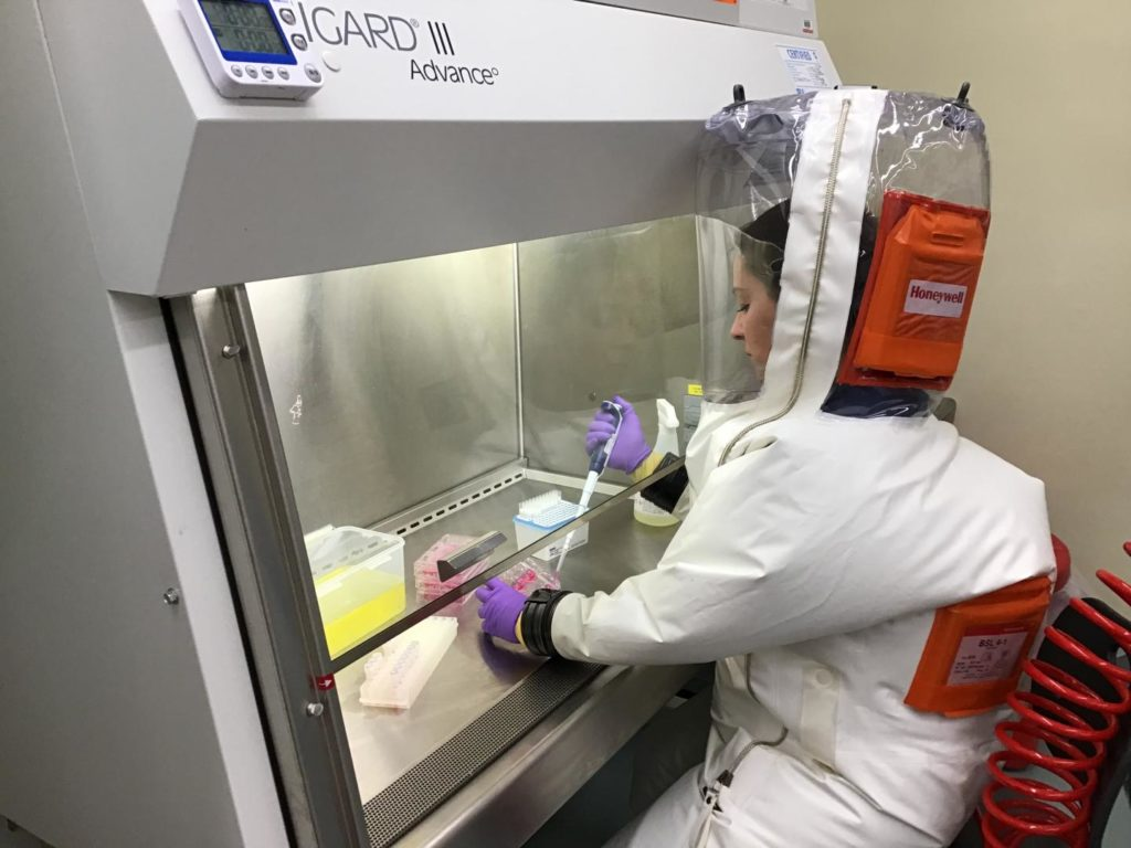 Researcher Anna Honko prepares the assay in the BSL-4 in the National Emerging Infectious Diseases Laboratories (NEIDL).