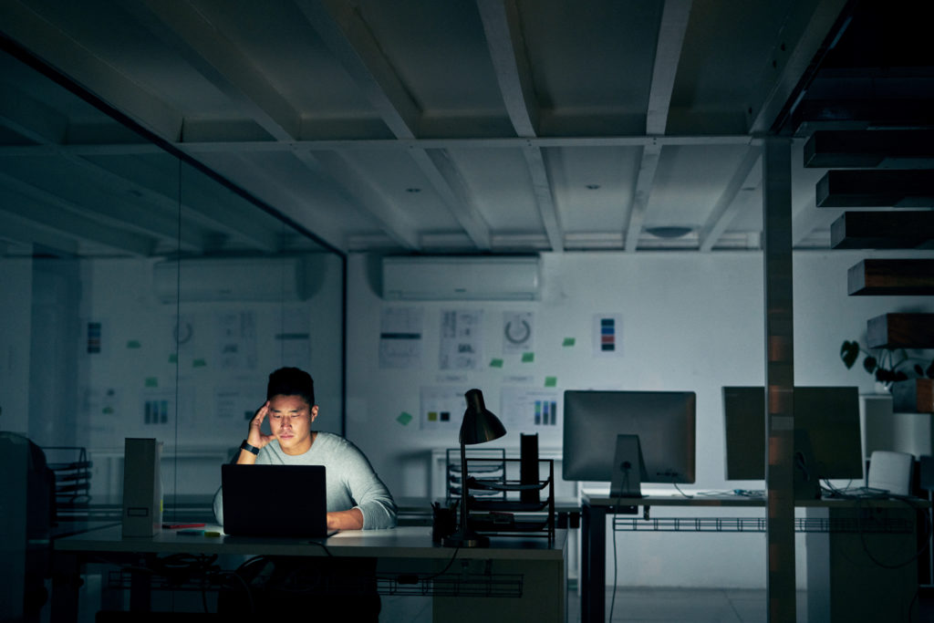 man alone in the office after hours