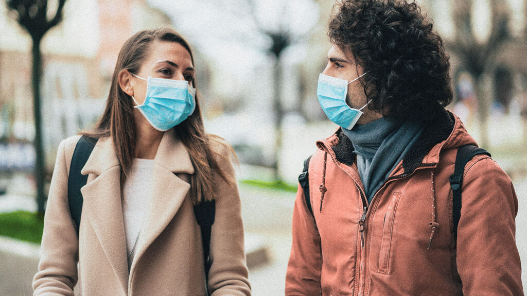 A couple walks in the fall to accompany an article about weather and COVID-19.