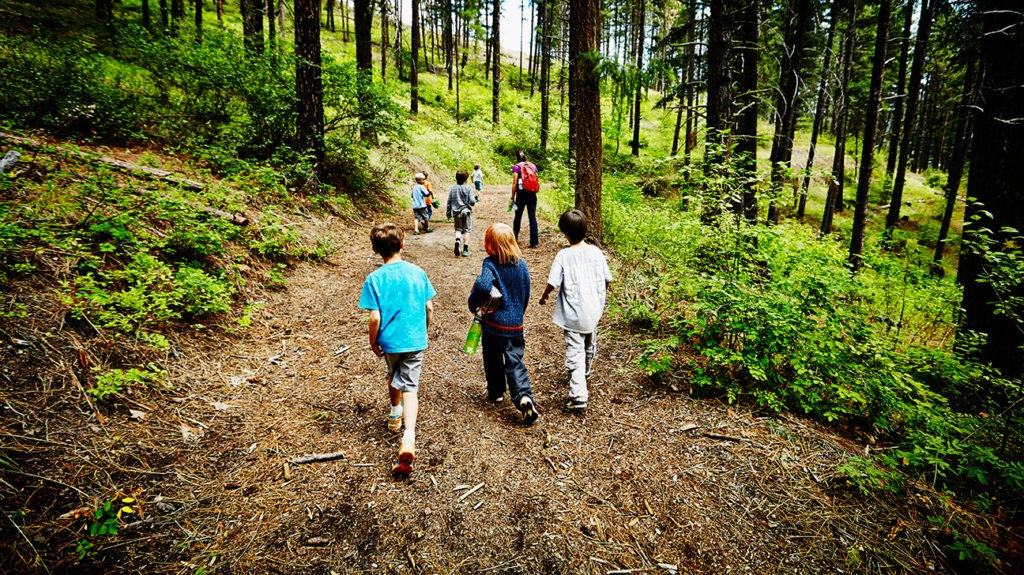 kids on a trek at a summer camp where a COVID-19 outbreak may happen