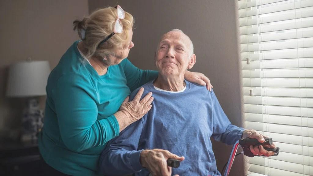 Older adult smiling at a caregiver
