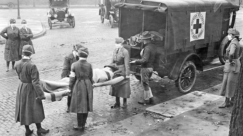 Members of the American Red Cross remove Spanish influenza victims from a house at Etzel and Page avenues in 1918. (St. Louis Post-Dispatch file photo/Tribune News Service via Getty Images)