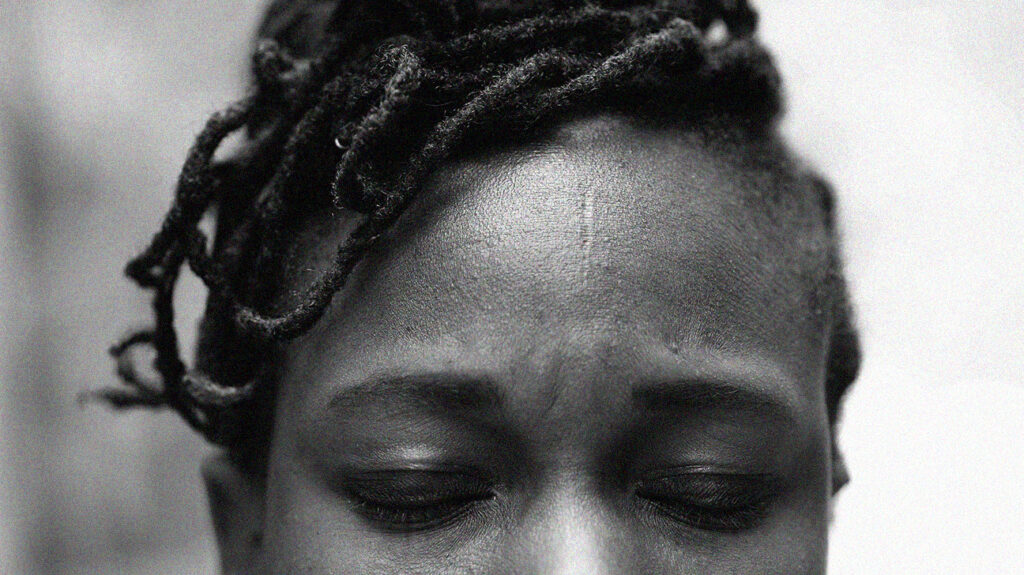 Close up of a woman's head with closed eyes