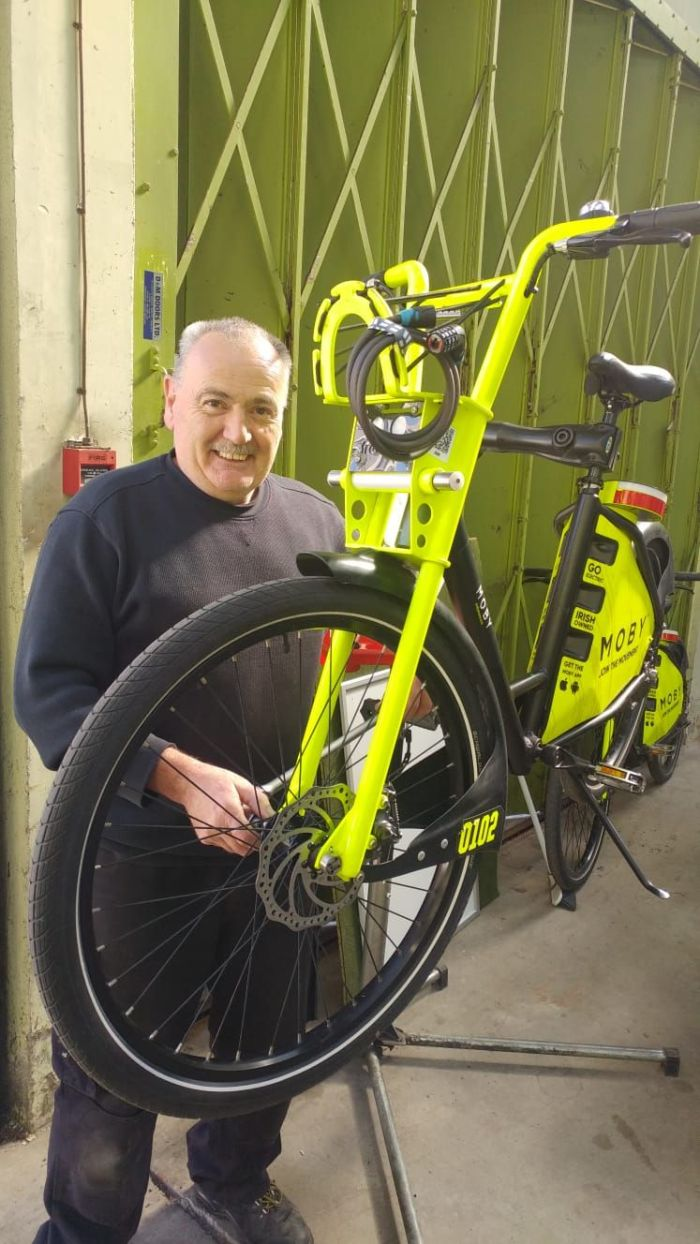 Bike mechanic Eamonn Newton in the workshop