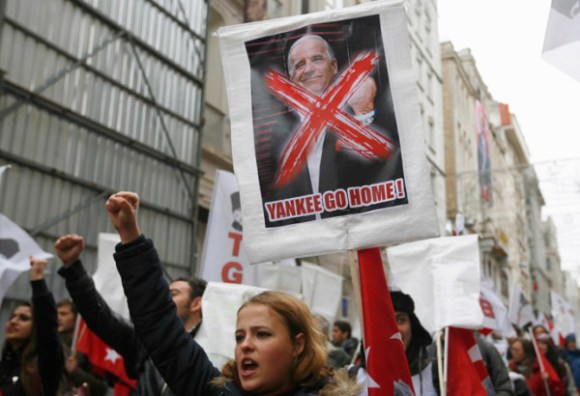 Left wing demonstrators shout anti-U.S. slogan during a protest against the visit of U.S. Vice President Biden, in central Istanbul