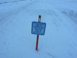 join a snowmobile club trail sign