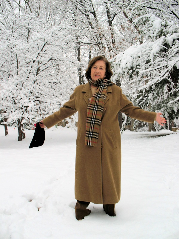 Photo: bundled-up woman against snowy backdrop