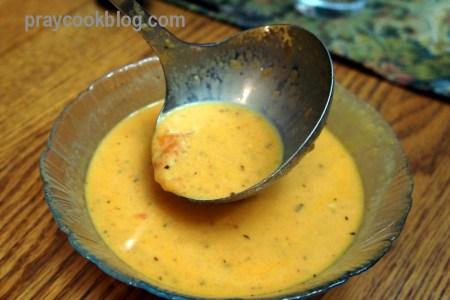 fresh tomato soup ladled