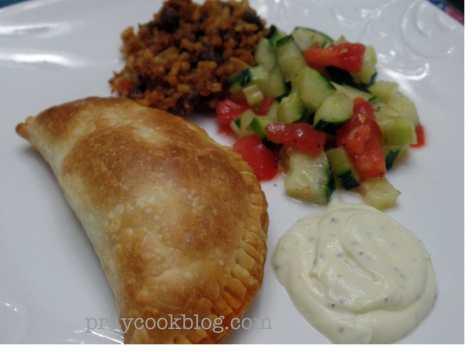 Plate Empanada and cuc tom salad