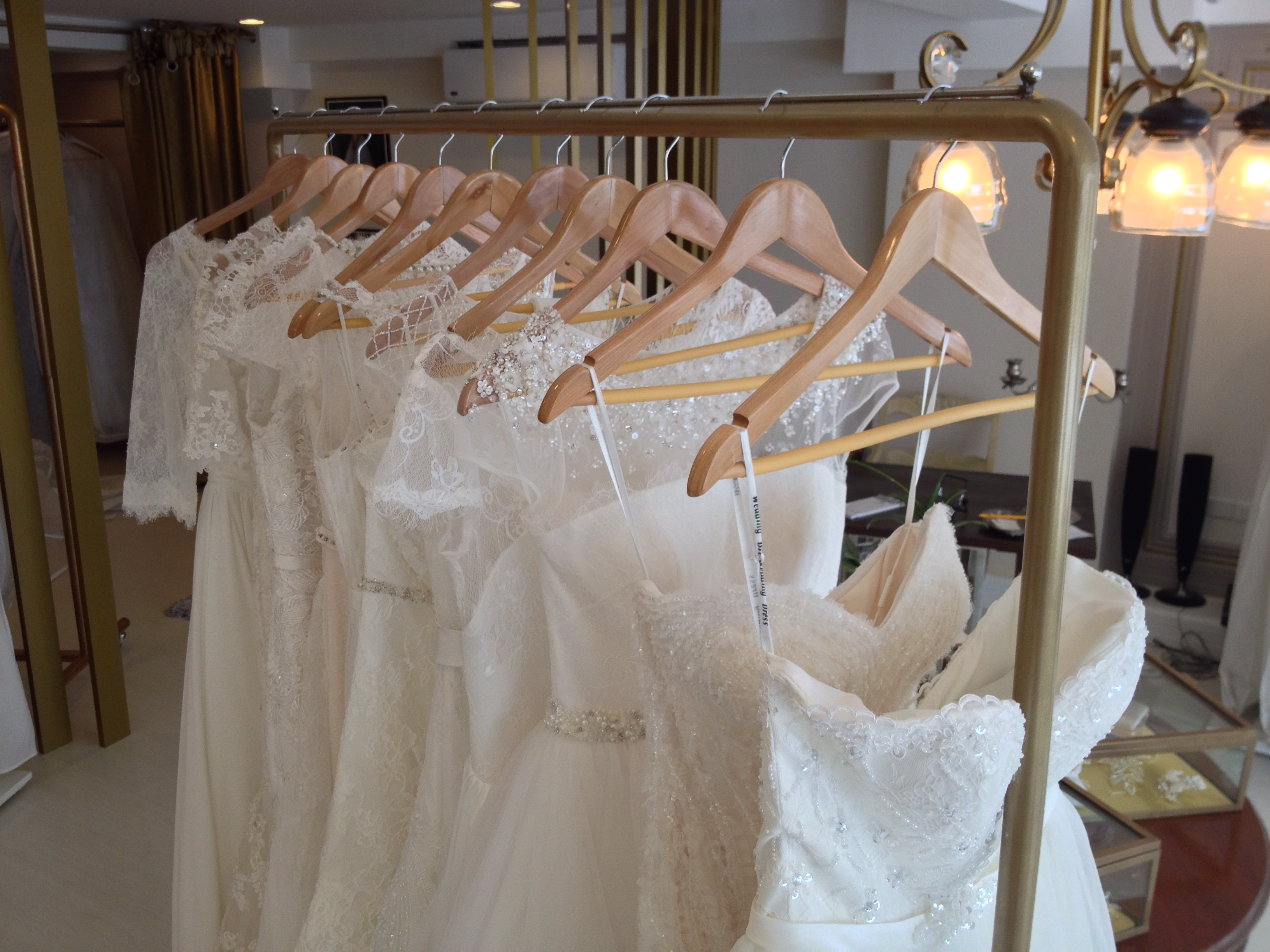 would you rent a wedding gown rent a wedding dress A rack of bridal gowns available for rent at The Bridal Room