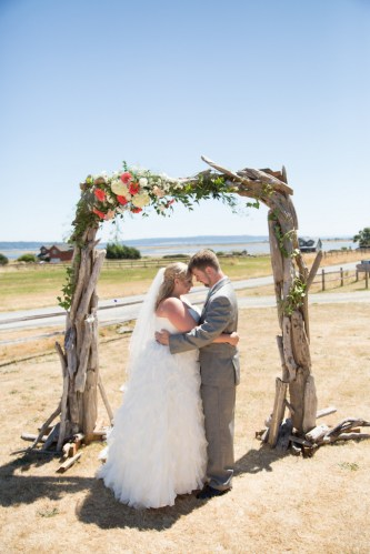 plus size wedding gown, plus size bride, tulle, plus size david's bridal wedding gown, groom, ceremony, wedding arch