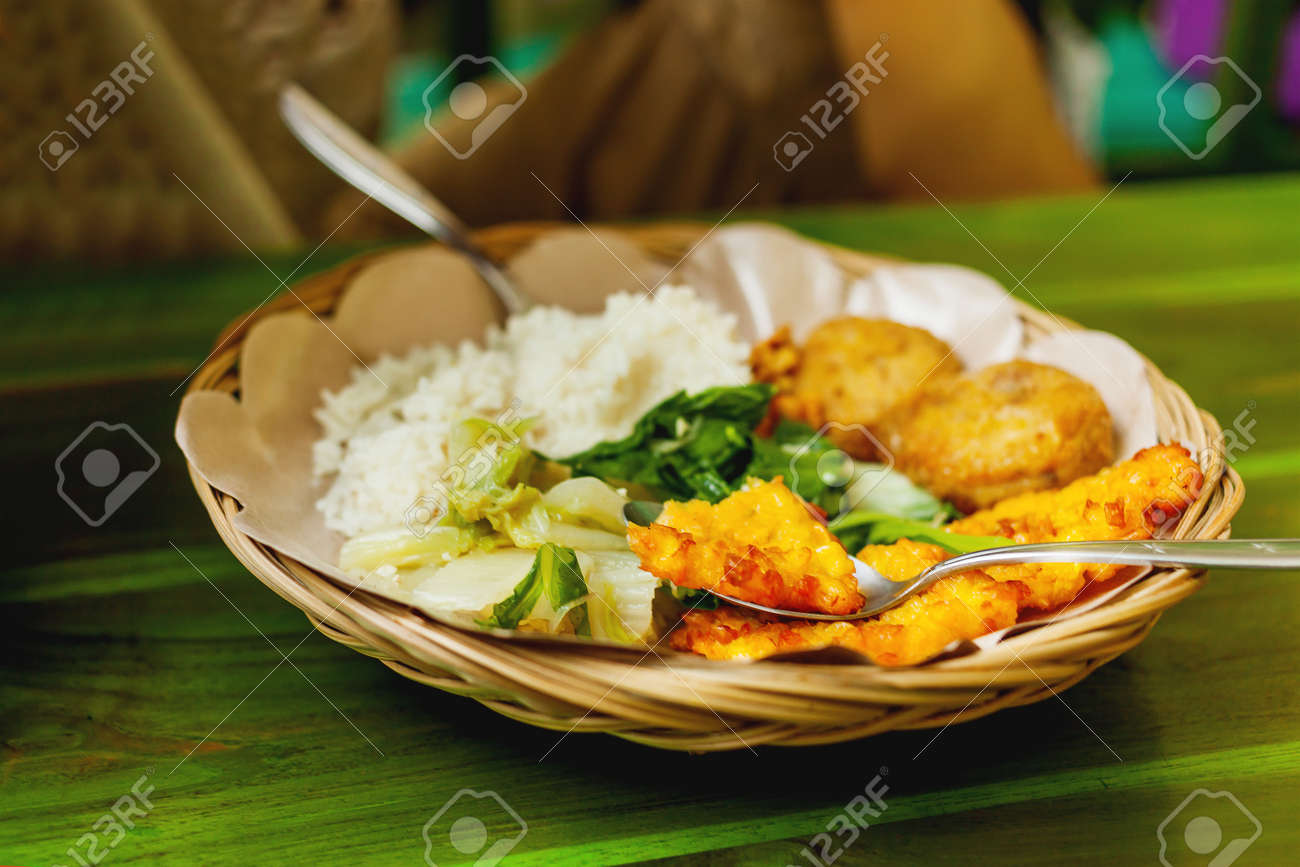 Cuisine Bali Asian Cuisine Rice With Stir Fried Vegetables And Corn Cutlet