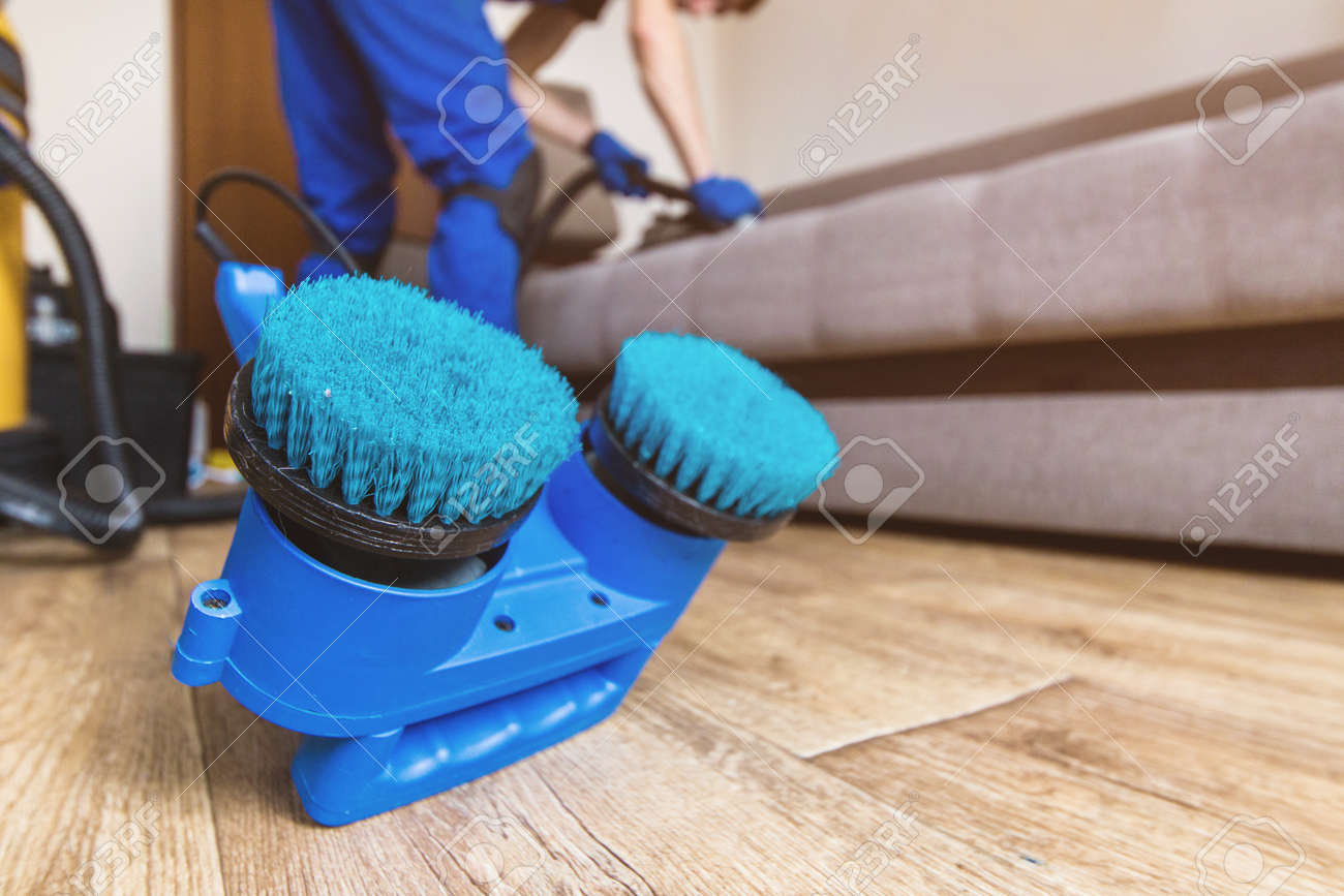 Sofa Vacuum Cleaner Brush Cleaning Service Man Janitor In Gloves And Uniform Vacuum Clean