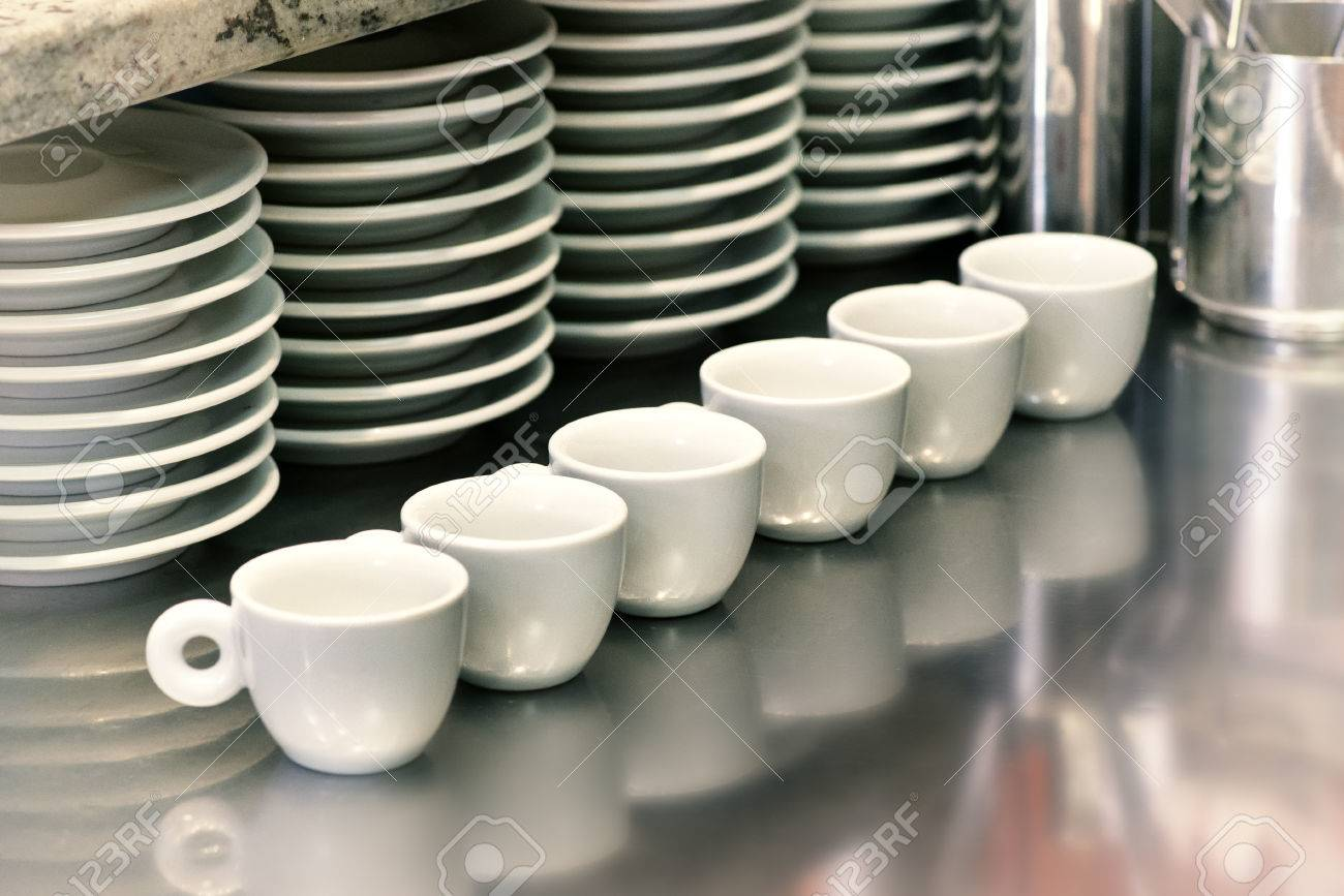 Small Coffee Cups And Saucers Small Coffee Cups Lined Up On A Metal Cafeteria Or Coffee House