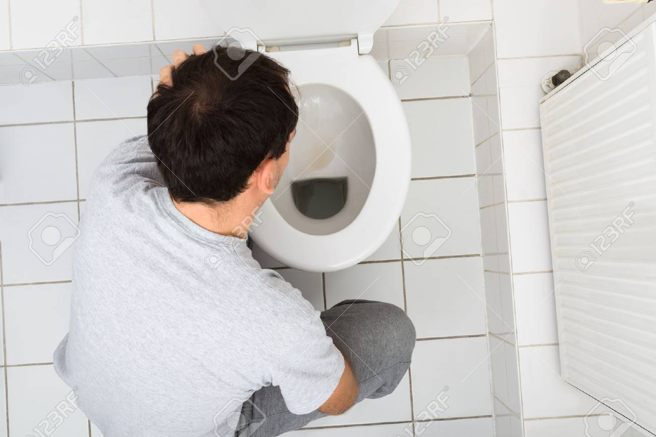 Commode Angle High Angle View Of A Man Vomiting In Commode