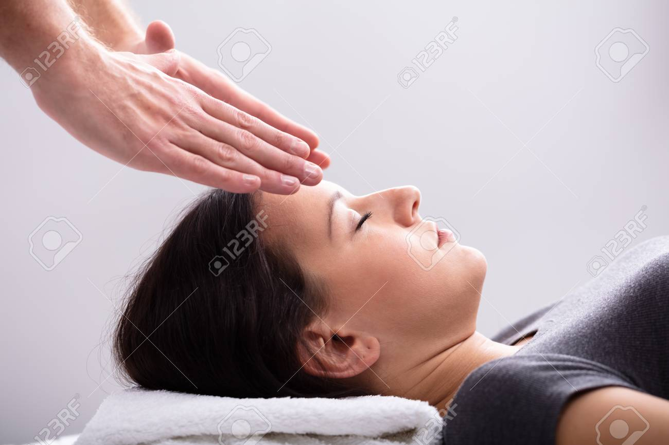 Healing Treatment Close Up Of A Therapist Hand Giving Reiki Healing Treatment To