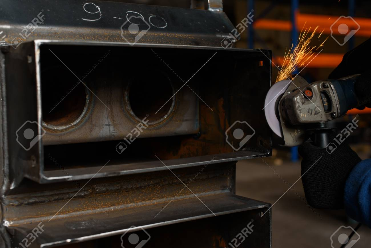 Closein Boiler Close Up Of Man Soldering Black Solid Fuel Boiler