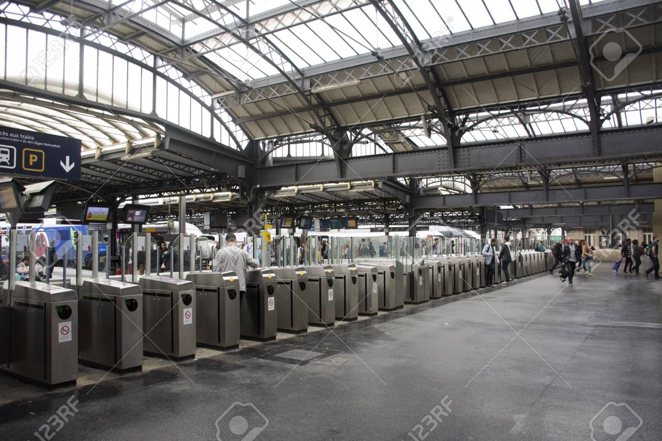 Gare De Paris French People And Foreigner Travlers Walk And Wait Train At Gare