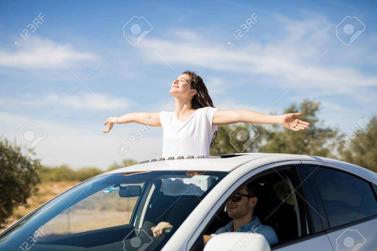 Travel Buggy With Sunroof Beautiful Young Couple Is Travelling By Car With Girl Standing
