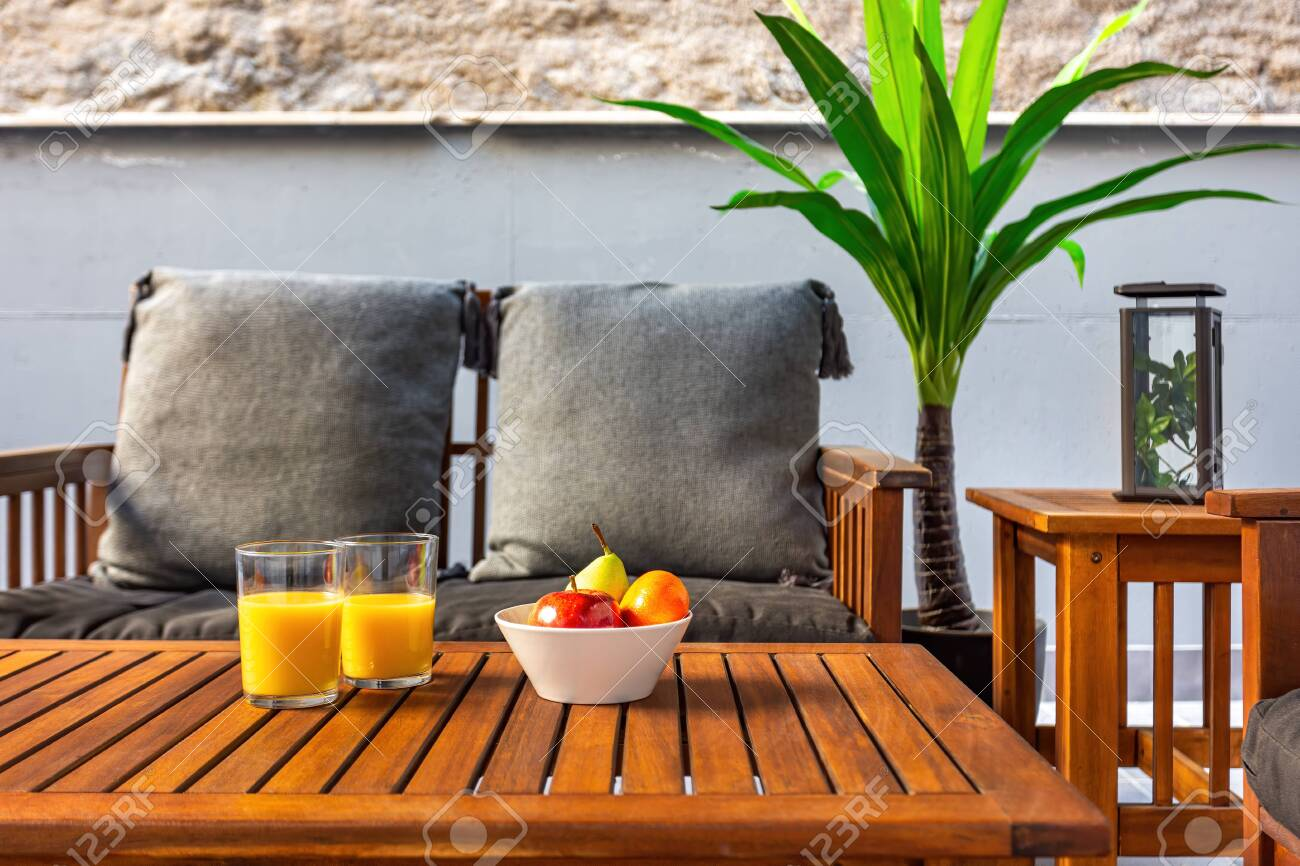 Terrace With Wooden Table Sofa And Chairs Fruits And Orange Juice At The Table Having Healthy Breakfast At Home Vacation And Travel Concept Bed And Breakfast Lizenzfreie Fotos Bilder Und Stock Fotografie