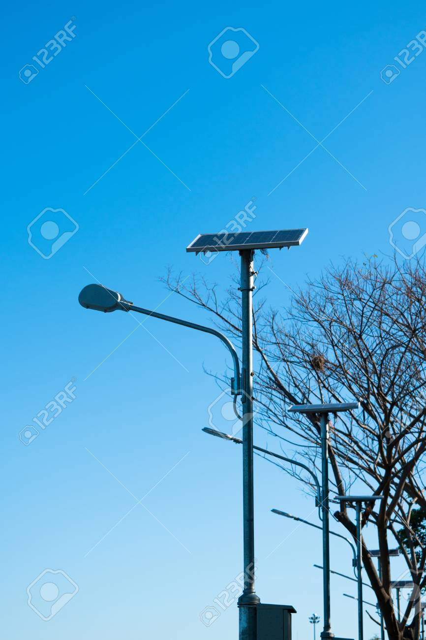 Solar Lamp Post Solar Lamp Post On The Blue Sky And The Tree In The Background