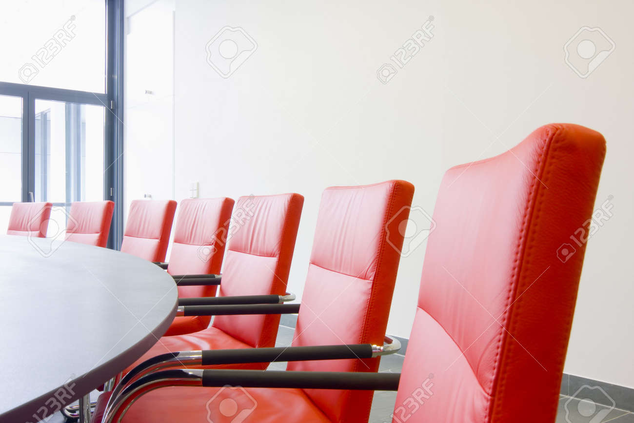 Red leather chairs in a conference room stock photo 3365389