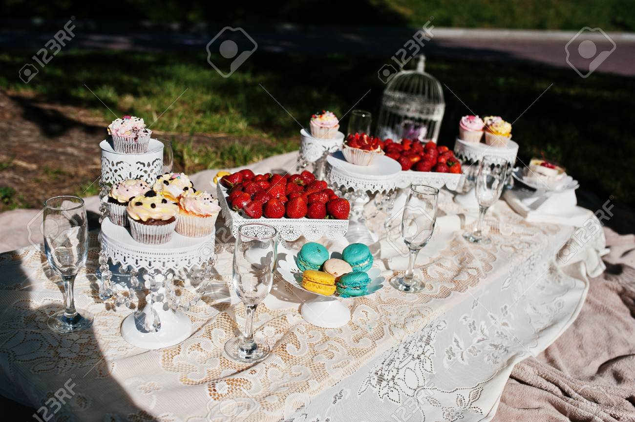 Picnic Decor Picnic Table With Decor On Grass With Macaroon Strawberry And
