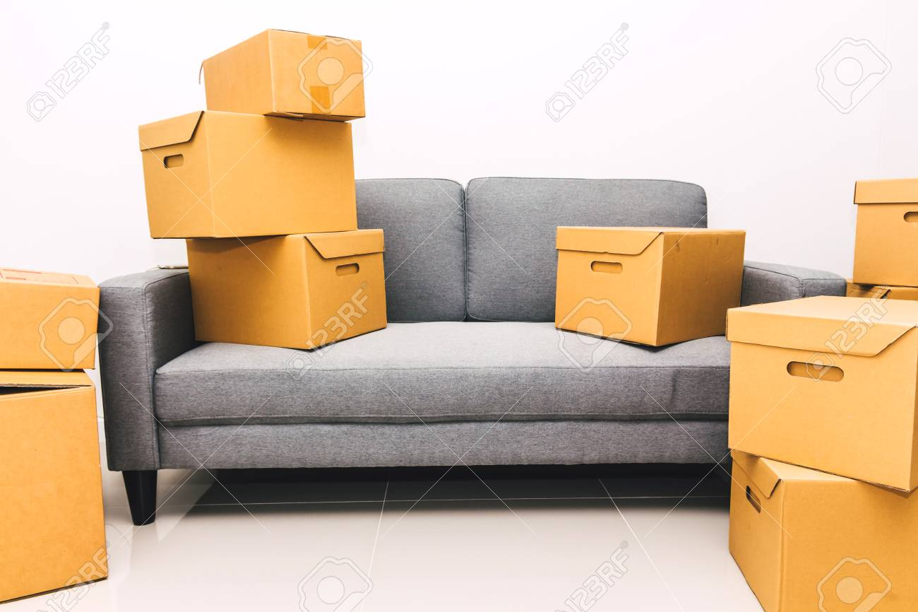 Home Sofa In A Box Pile Of Cardboard Box On Sofa At New Home Moving Home Concept