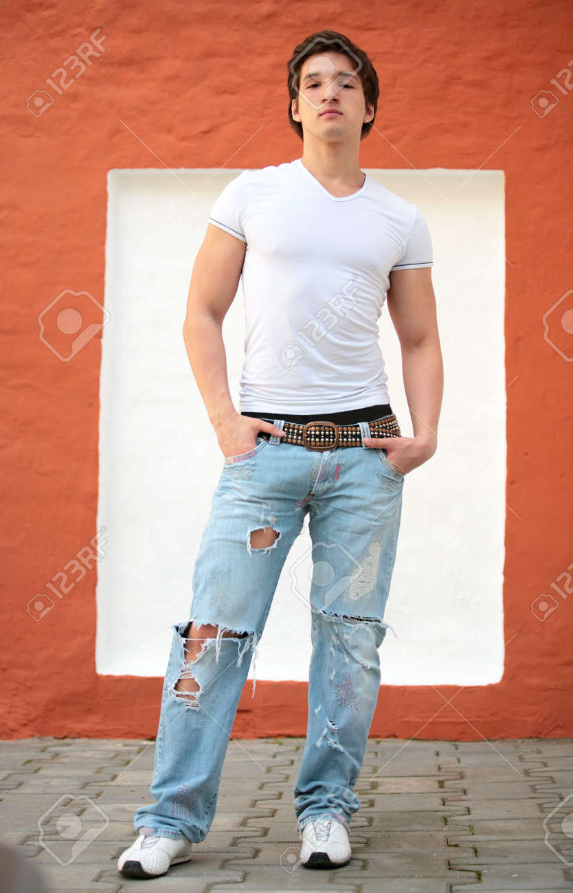 White t shirt blue jeans stock photo portrait of the young man in white t