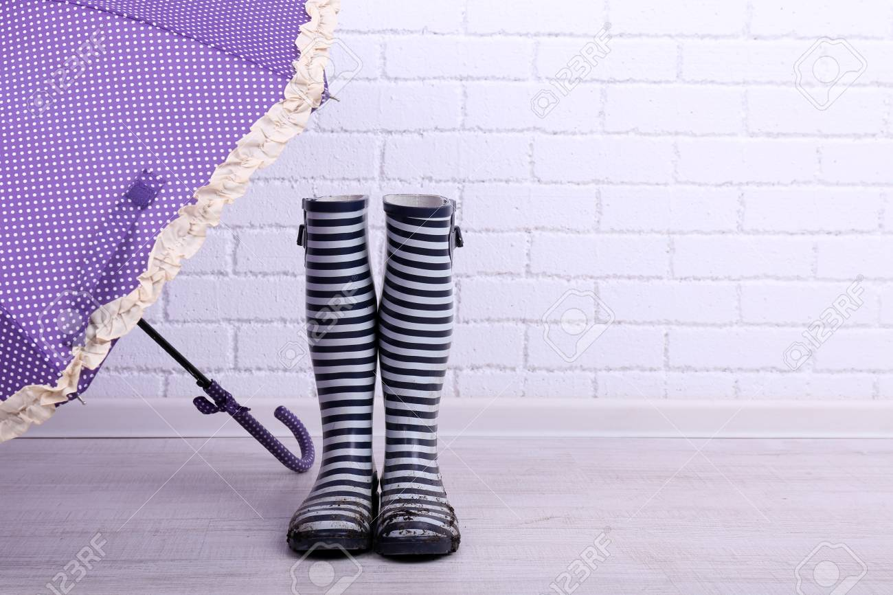 La Chambre Wellington Boots Dirty Wellington Boots With Umbrella On Floor In Room