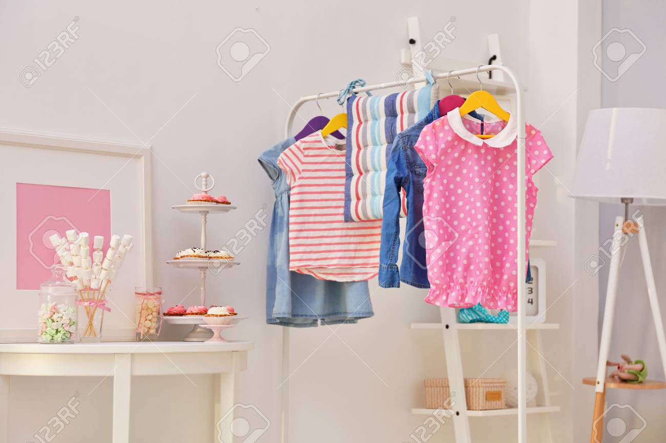 Cloth Hanger Stand Children Clothing On Hanger Stand In Dressing Room