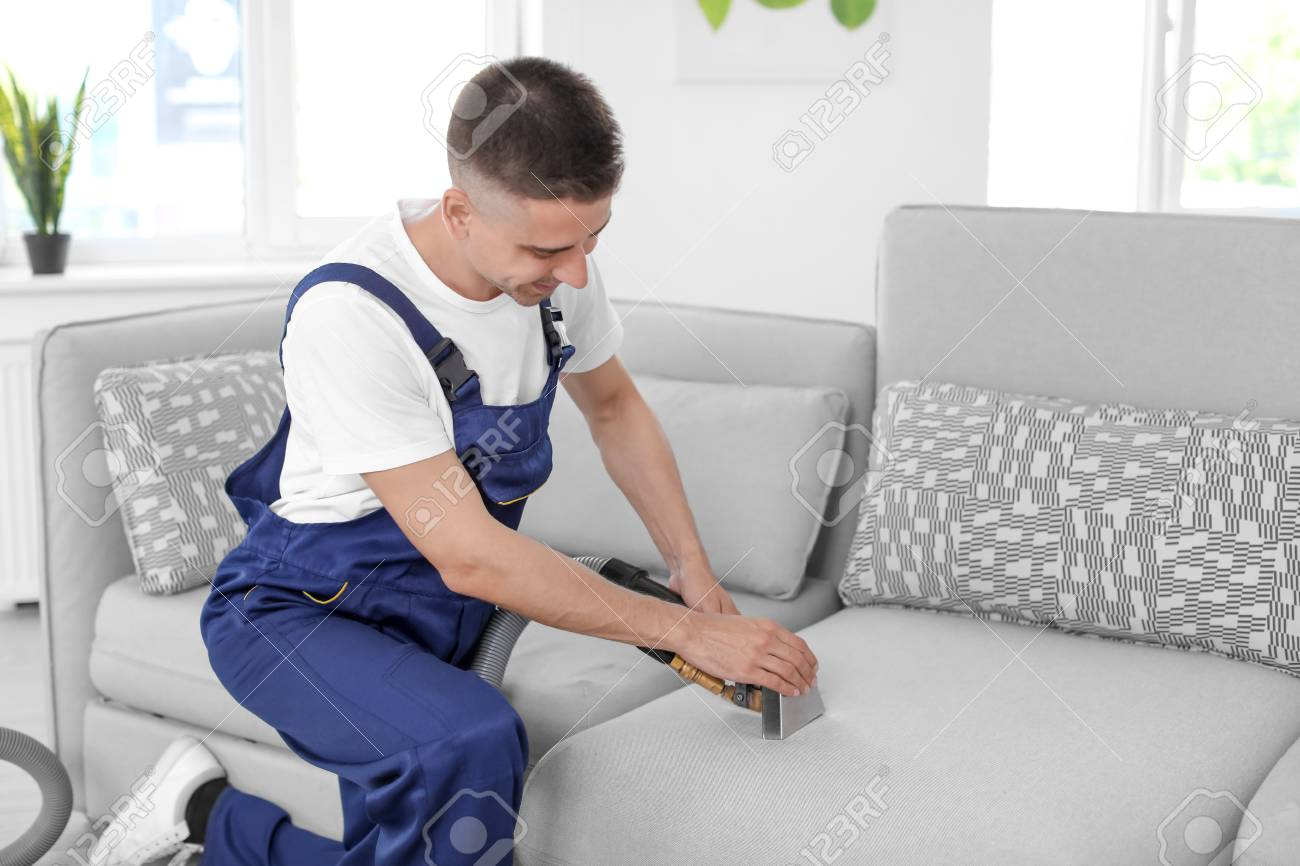 How To Dry Clean Sofa At Home Dry Cleaning Worker Removing Dirt From Sofa Indoors