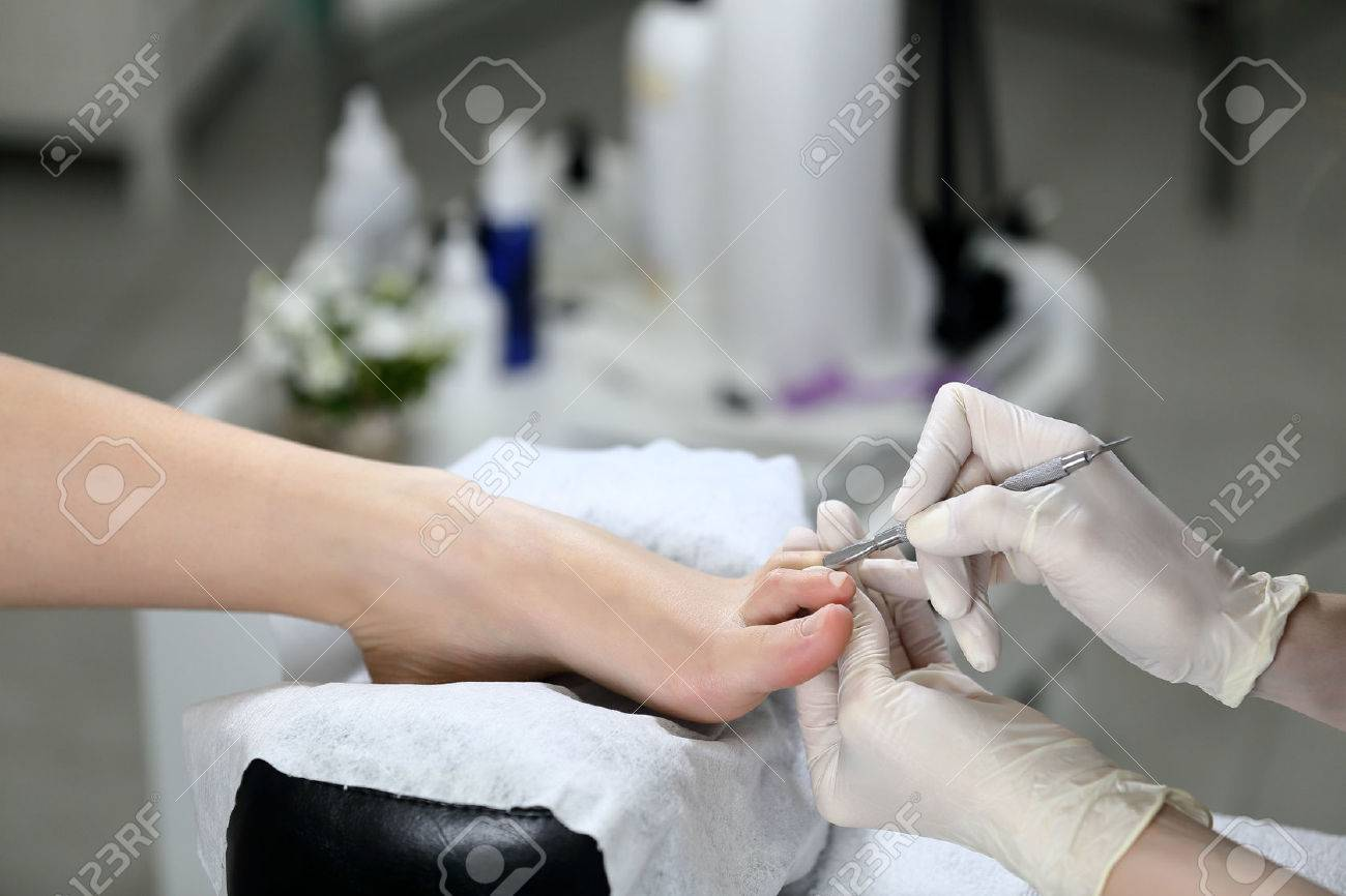 Pedicure Salon Woman Receiving Cuticle In Manicure Pedicure Salon