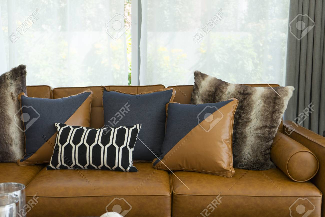 Modern Decorative Pillow On Brown Leather Sofa In Living Room Stock Photo Picture And Royalty Free Image Image 100513556