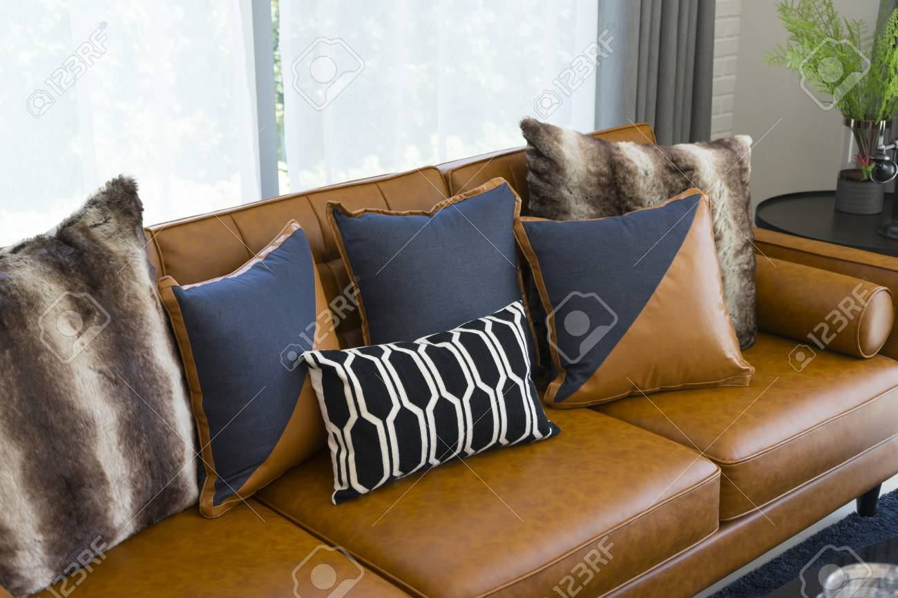 Modern Decorative Pillow On Brown Leather Sofa In Living Room Stock Photo Picture And Royalty Free Image Image 100513557