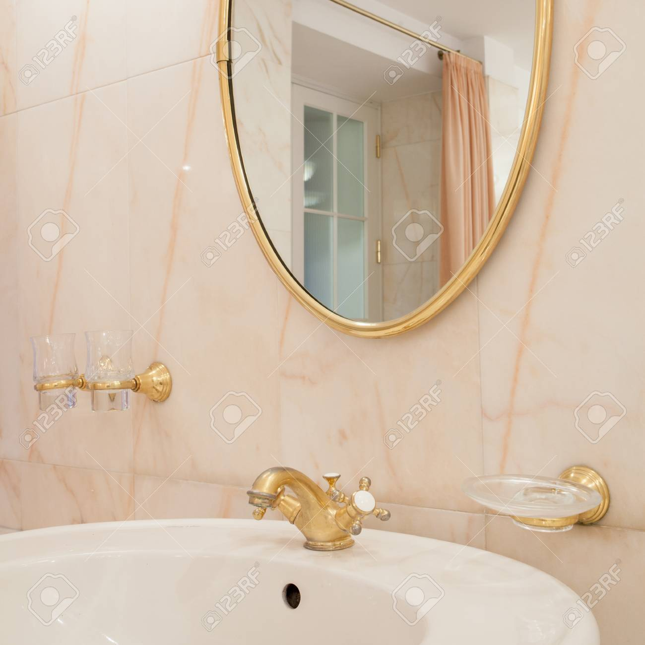 Oval Mirror With Gold Elements In Luxury Bathroom Stock Photo Picture And Royalty Free Image Image 55305471
