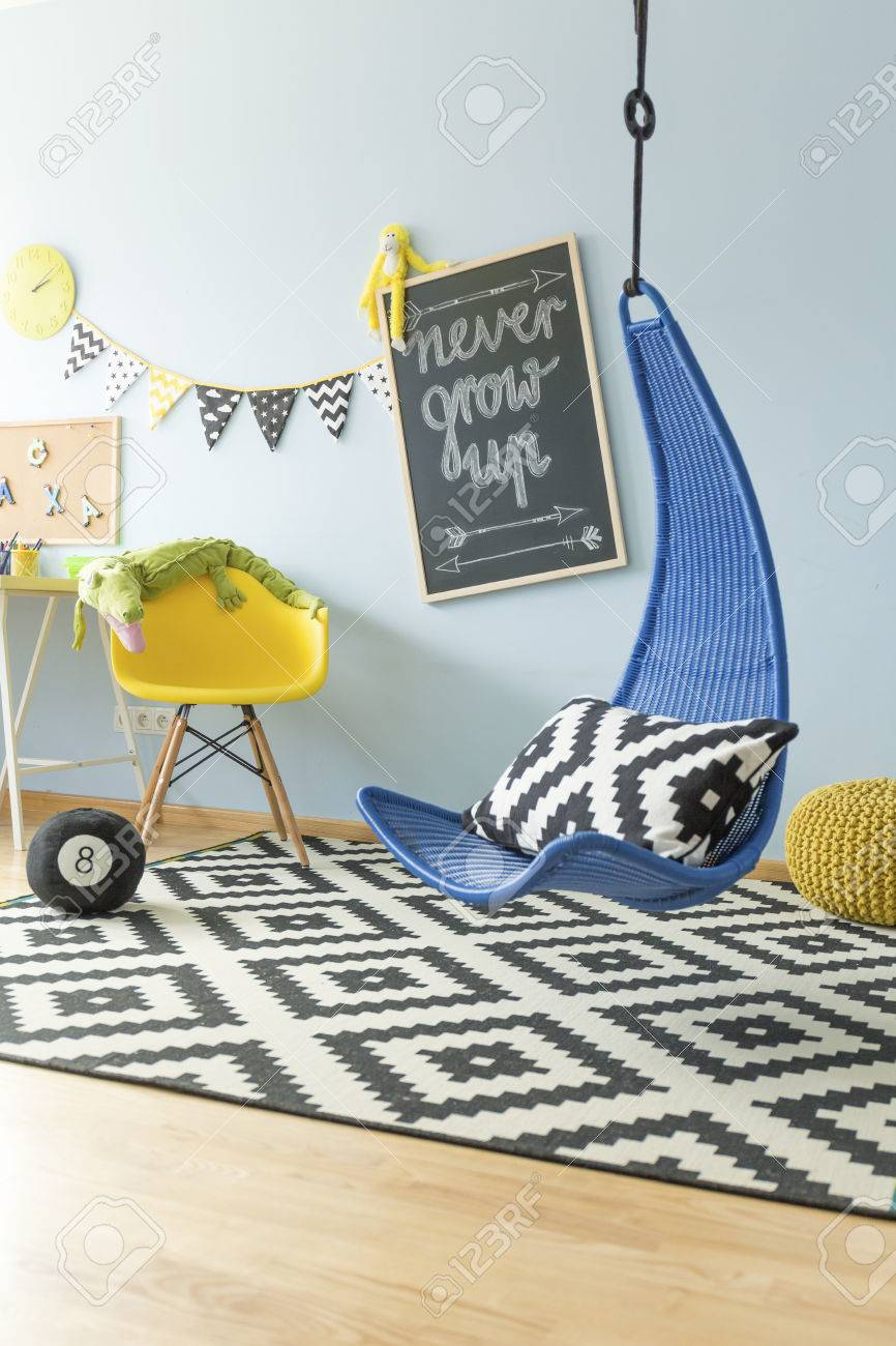 Modern Bright Teenager Room With Navy Blue Hanging Chair And Stock Photo Picture And Royalty Free Image Image 56467149