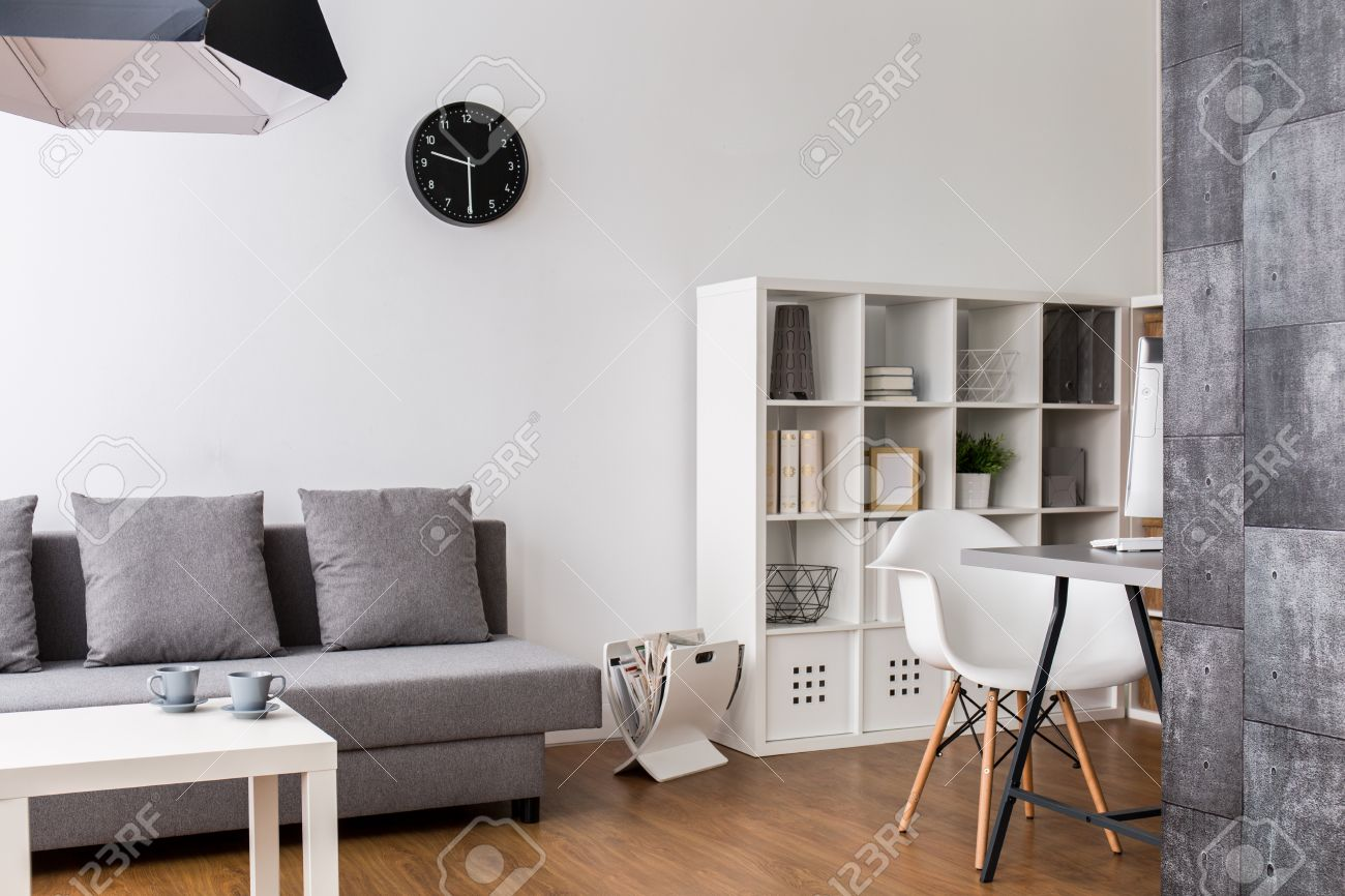 Minimalist Living Space Modern Minimalist Living Room With Resting Space Racks And Desk