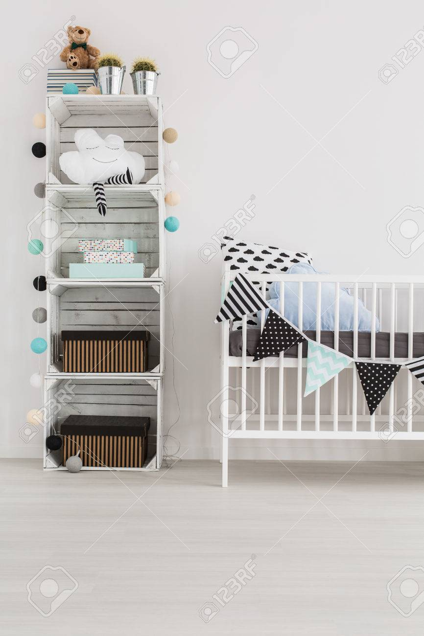 Babies Room Accessories Pallet Rack With Baby Accessories And White Crib In Baby Room