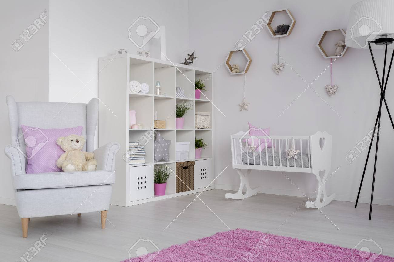 Babies Room Accessories Baby Room Corner With A Large White Rack Filled With Children S