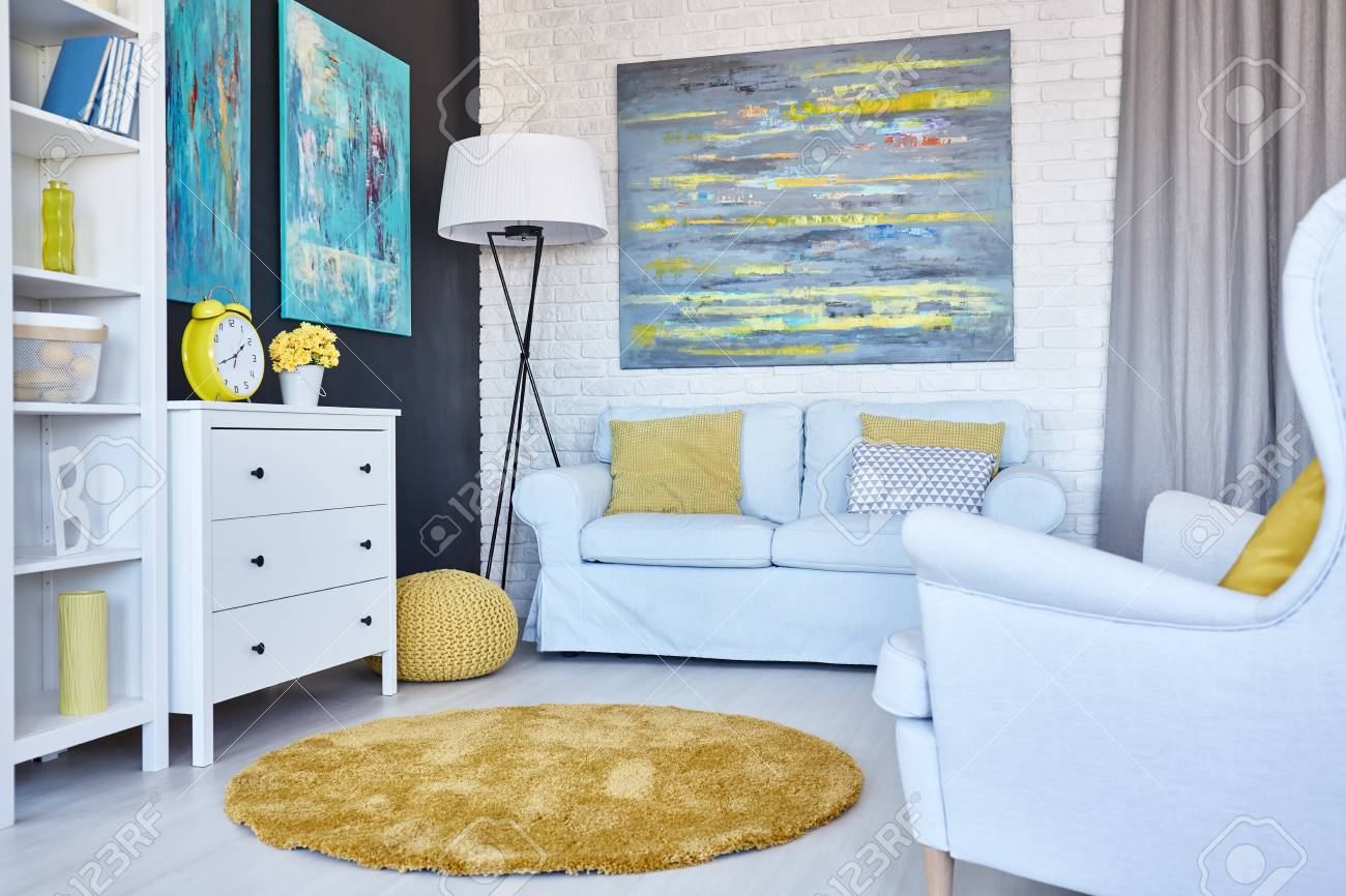 Living Room Paintings Modern Living Room Decorated With Paintings And Yellow Accessories