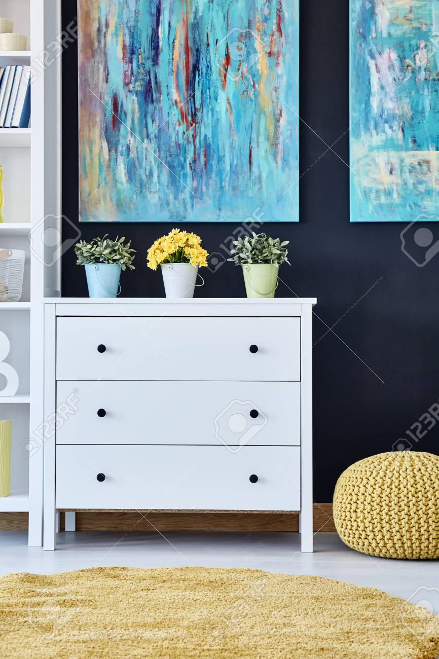 Living Room Paintings White Chest Of Drawers In Modern Living Room Decorated With Paintings