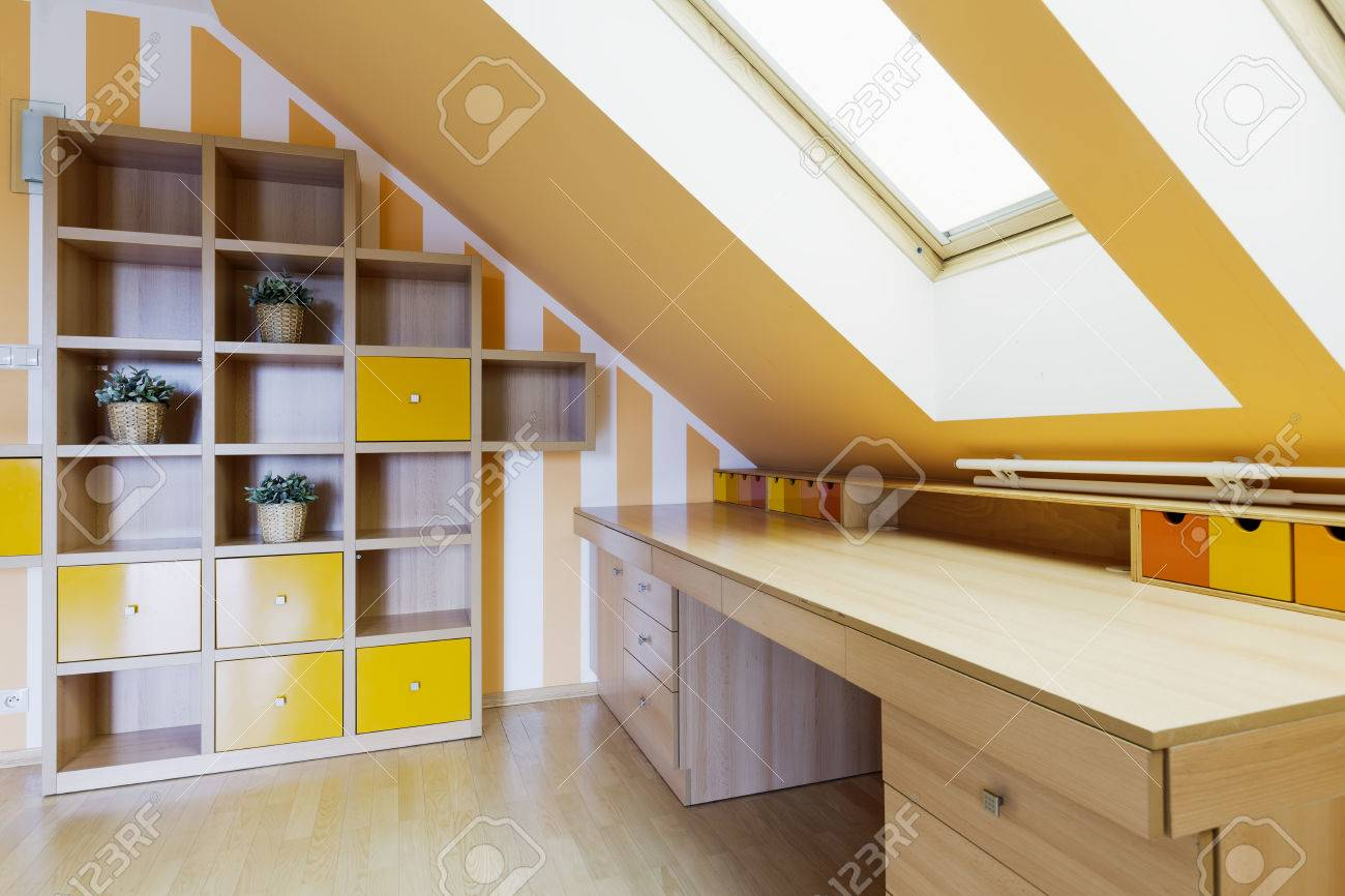 Long Wood Desk Yellow Office Room In An Attic With A Set Of Shelves And A Long