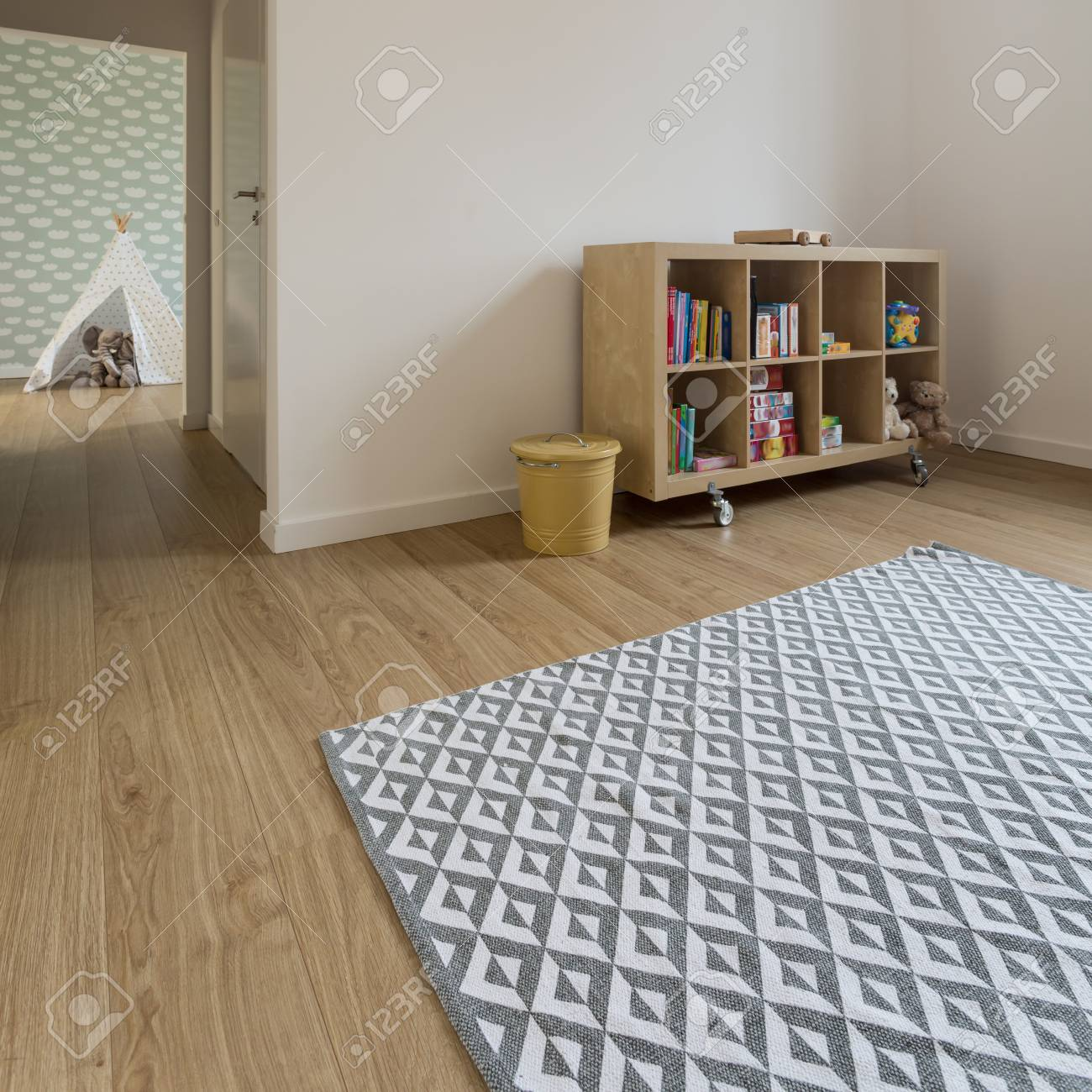 Patterned Carpet Spacious Play Room For Kids With Patterned Carpet Wooden Furnitures