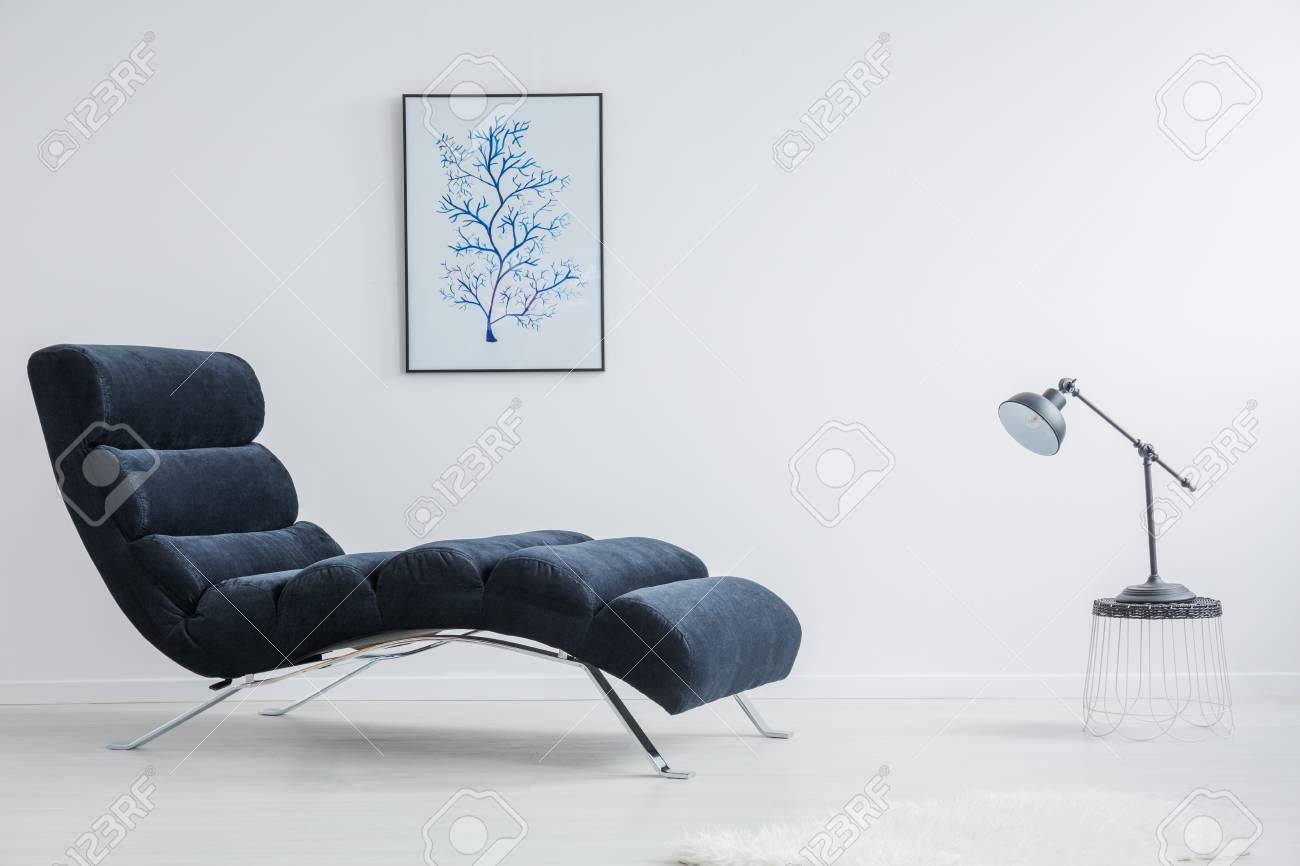 Chaiselongue Modern Designed Small Table With Black Lamp Stands Against Modern Chaise