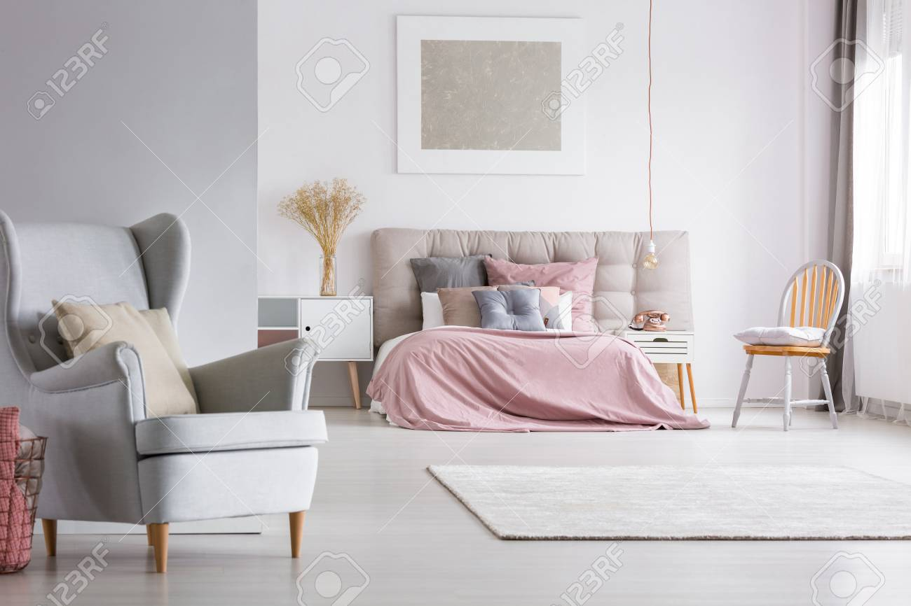 Scandinavian Furniture Bed Trendy Armchair In Cozy Spacious Interior Of Light Pastel Bedroom
