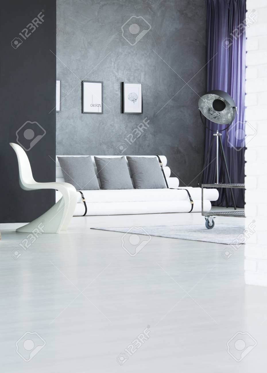 Designer Couch White Plastic Chair And Designer Sofa In Monochromatic Living