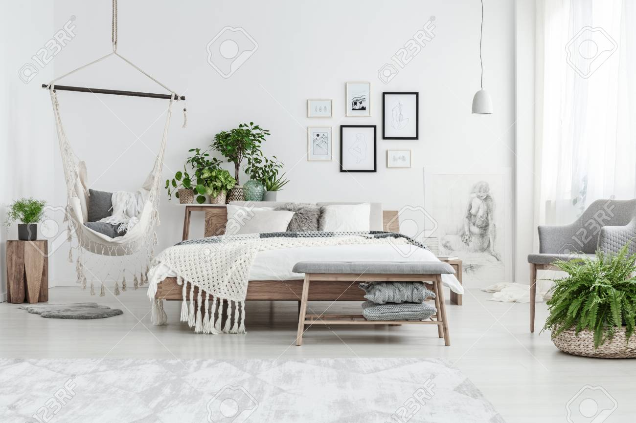 Simple Bed Fern And Bench In Simple Bedroom Interior With Wooden Bed Near